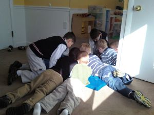 The boys at church around a DS