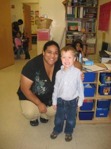 Grey in his classroom with his new TA, Melissa