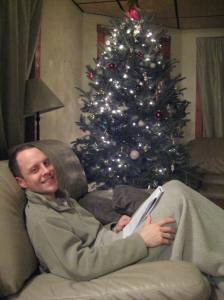 My husband in front of the tree