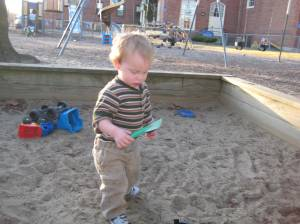 Thane loves the sandbox