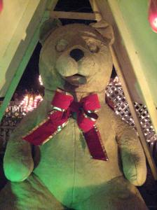 A greenish glow does not make giant teddy festive