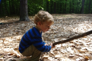A nearly preschooler looks for frogs