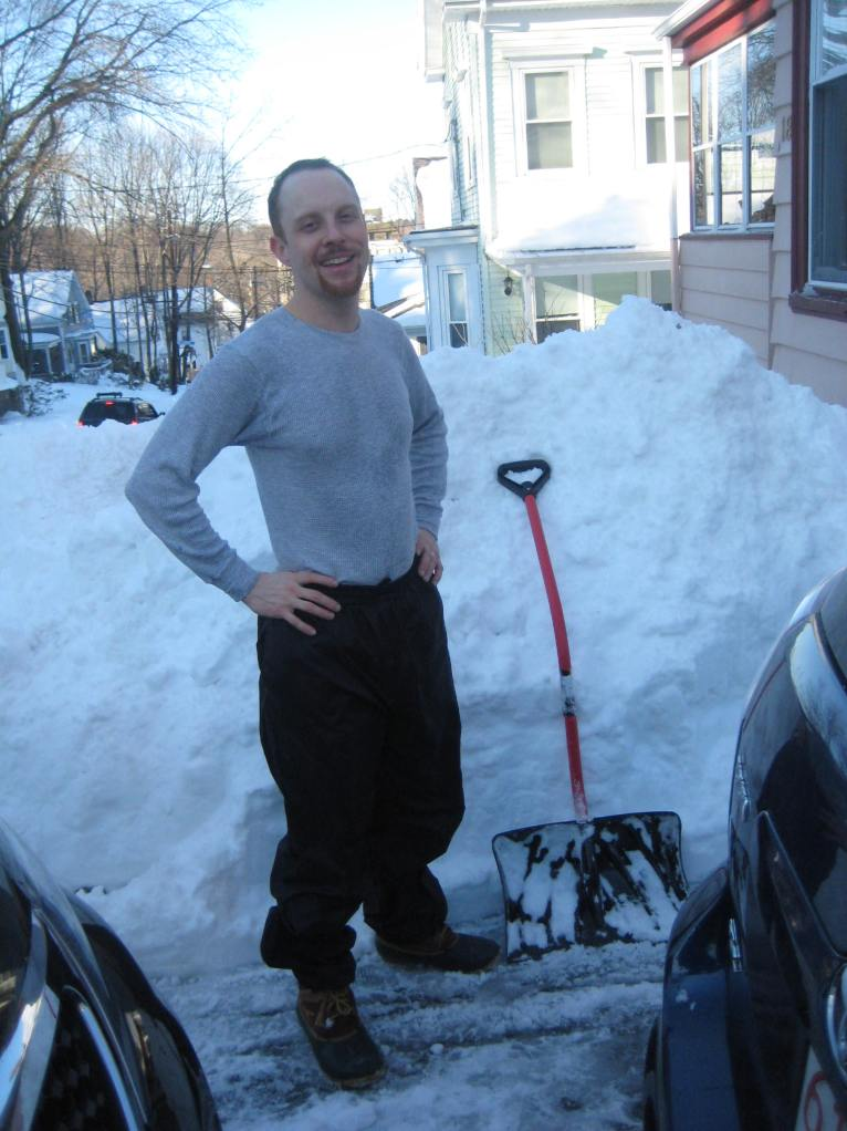 Adam stands on the drifts on the house-side of the driveway