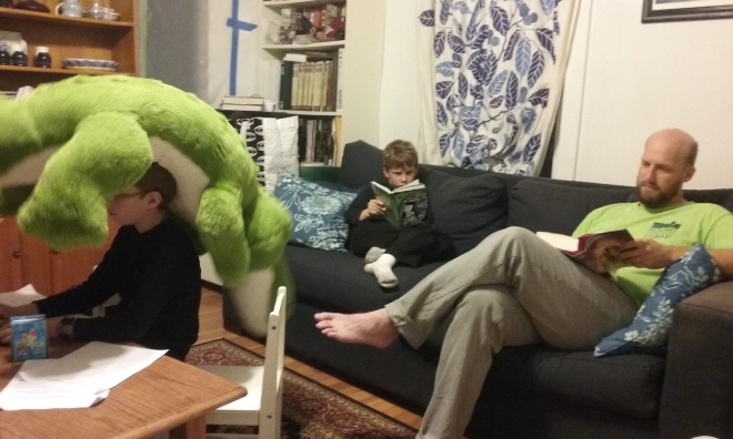 Doing his homework with stuffie help on Library/Pizza night.