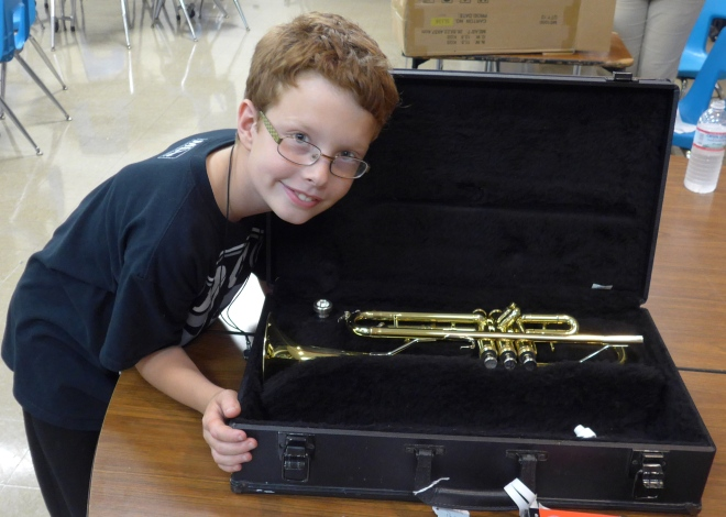 A boy and his new trumpet. OMG.
