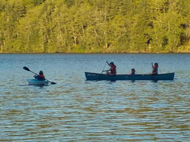 I love this picture - time for Thane to learn how to paddle his own canoe