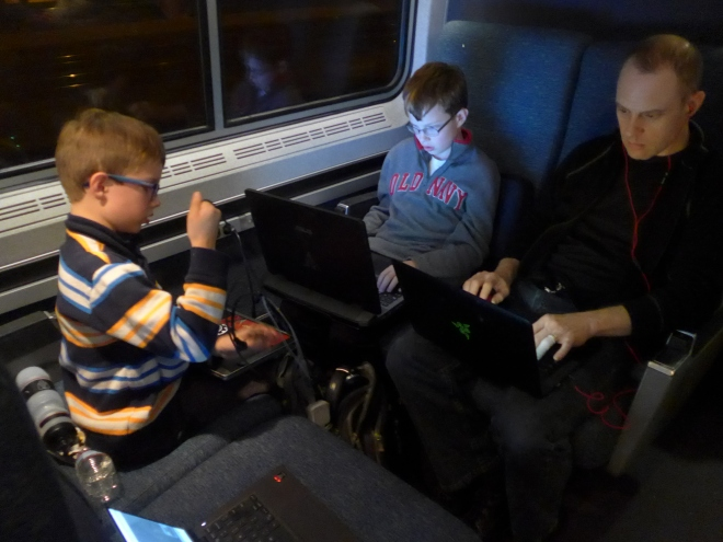 Train ride to Washington - the glow of the screens compels you